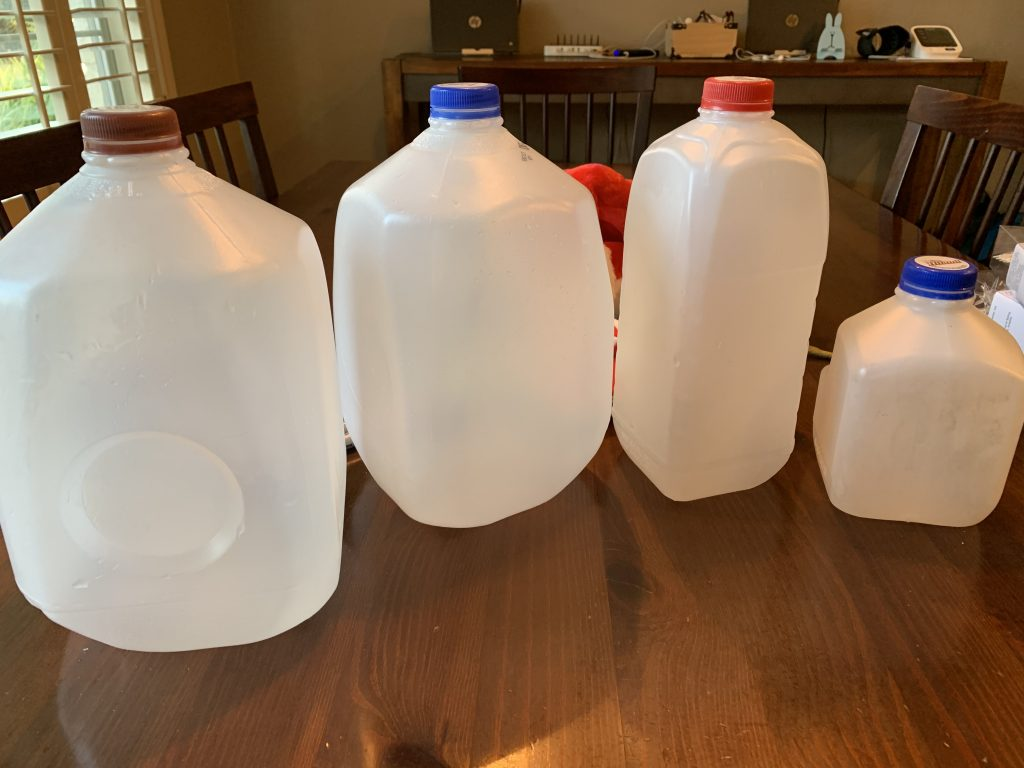 Empty milk jugs.